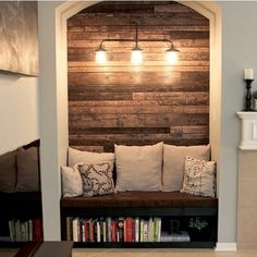 Love the reclaimed wood wall.. lovely nook