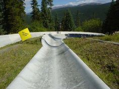 """An alpine slide is a long chute on the side of a hill, usually built by ski resorts to supplement summer income. A wheeled cart is used to navigate the … Continue reading """"Alpine Slide"""" Lutsen Resort, Alpine Slide, Winter Park Resort, Minnesota Camping, The Parking Spot Hobby, Travel Humor, Funny Travel, Camping Resort, Denver City"""