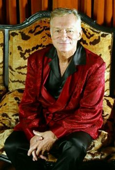 HUGH HEFNER Oh my gosh! The maroon silk  robe and the cheetah print chair! What a combo to seduce a woman! I can hardly contain myself! Do you think I'm being a bit sarcastic?