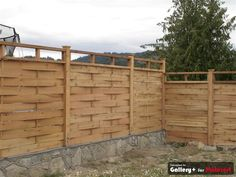 basket weave fence:: I like this one. leave it open or install lattice? Maybe corrugated steel?