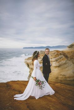 Love this wedding photo with the coastal cliff setting.