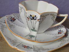 Antique tea cup and saucer plate set trio, vintage 1920's Shelley china art deco tea cup, English tea set. $169.00, via Etsy.