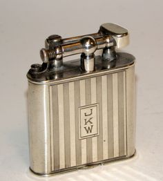 1920 s art deco engine turned sterling silver swiss dunhill  B  liftarm lighter.