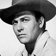 Howard Keel, in all the greatest movies ever! Seven Brides for Seven Brothers, Calamity Jane, Kiss Me Kate, and Annie get Your Gun. All my favorites!