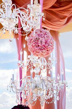 pretty chandelier and flower arrangement for wedding