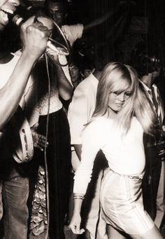 Brigitte Bardot at a party, 1960s