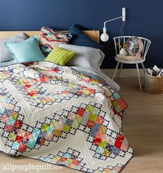 """On the Bright Side: Stitch up a galaxy of miniature eight-point stars to make a king-size bed quilt. Designers: Jo Kramer and Kelli Hanken of Jo's Country Junction. Finished quilt: 96-1/2"""" square. Finished block: 12"""" square."""
