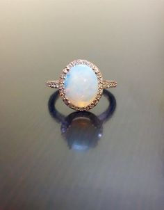 18K Rose Gold Halo Diamond Opal Engagement Ring   by DeKaraDesigns  Dear future husband…..