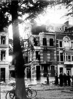 Netherlands in WW2 - Maastricht, July 8th 1941. Allied bomber shot down by the Germans over Maastricht. The plane went down in the Wilhelminasingel near the Bourgognestreet. Several minutes later two bombs exploded. The crew had left the burning plane but died.They left the plane at a low altitude and their parachutes didn't open. their bodies were recovered in bordering houses.