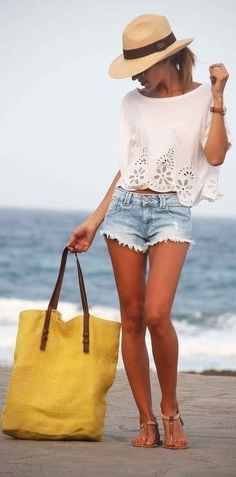 A white eyelet cropped top and light blue denim shorts are a great outfit formula to have in your arsenal. Complement this look with brown leather thong sandals.   Shop this look on Lookastic: https://lookastic.com/women/looks/cropped-top-shorts-thong-sandals-tote-bag-hat-watch/11774   — Khaki Straw Hat  — Brown Leather Watch  — White Eyelet Cropped Top  — Light Blue Denim Shorts  — Yellow Canvas Tote Bag  — Brown Leather Thong Sandals