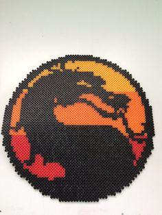 Mortal Kombat Logo Perler Beads by TalkNerdytoMePerler on DeviantArt Pixel Art, Hama Beads Patterns, Beading Patterns, Perler Bead Art, Perler Beads, Arte 8 Bits, Stitch Character, Pixel Beads, Art Perle