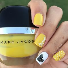 Yellow love manicure. Heart nails.