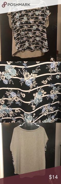 A shirt The back is grey and it has a floral print on the front white stripes torrid Tops Blouses