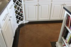 A custom wine rack allows for quick and easy access in the corner of the bottom cabinets.