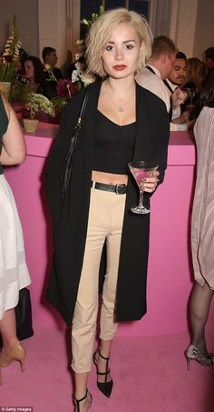 Cocktail time: Singer Nina Nesbitt was sipping on a tasty looking drink...