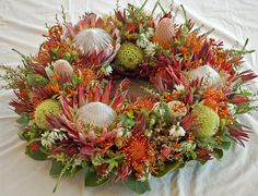 King Protea Wreath #CaGrown #Protea Wreath Crafts, Wreath Ideas, King Protea, Wreaths And Garlands, Circular Pattern, Funeral Flowers, Circle Shape, Xmas Ideas, Flower Ideas