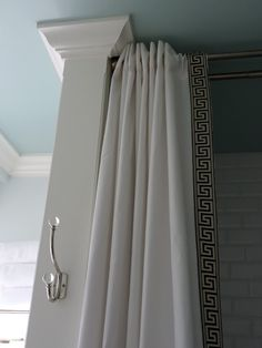 Shower Curtain, DIY Style  2 flat bedsheets + 6 yards of fancy trim + 1 double shower rod = this