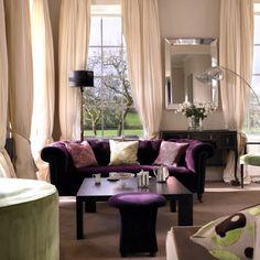 Love the window treatments and purple sofa