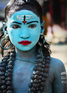 Little boy dressed as the Hindu god Lord Shiva