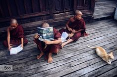 Novice monks study at a monastery in Nyaung Shwe township southern Shan state Myanmar. by exiter. Please Like http://fb.me/go4photos and Follow @go4fotos Thank You. :-)