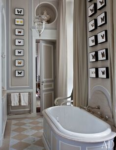 A master bathroom designed by Jean Louis boasts soaring ceilings | archdigest.com Deniot designed the master bath's tub surround, limestone-and-marble floor, and paneling, which is decorated with framed butterfly specimens from Deyrolle; the lantern is by Vaughan, the curtains are made of a Pierre Frey satin, and the tub fittings are by Volevatch.