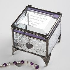 This beautiful glass vintage jewelry box is the perfect home for all of her treasures.  The beveled glass lid can be engraved with your heart-felt, personal message and a closing sentiment in beautiful script lettering.