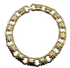 Check boring at the door when you walk in the room wearing Givenchy's golden textured link choker.