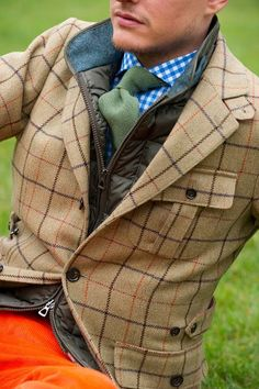 Shop this look on Lookastic:  http://lookastic.com/men/looks/tie-and-longsleeve-shirt-and-gilet-and-jeans-and-blazer/1702  — Dark Green Wool Tie  — White and Blue Gingham Long Sleeve Shirt  — Olive Gilet  — Orange Corduroy Jeans  — Tan Plaid Wool Blazer