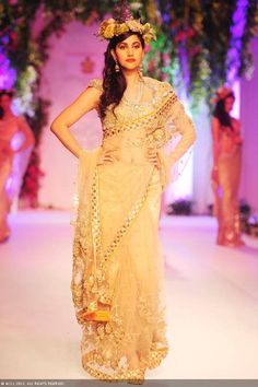 A model displays a creation by designers Falguni and Shane Peacock on Day 3 of India Bridal Fashion Week in New Delhi on July 25, 2013