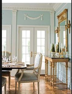 Blue & ivory color palette is combined with gorgeous parquet floors.This Formal Dining Room is very elegant with its antique French style & furniture.