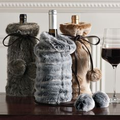 When giving the gift of wine or other fine spirits this Winter, bundle up those bottles in a glamorous yet warm and cozy way inside these cool new Faux Fur Wine Bottle Covers. Very faux, very festive, very funny.
