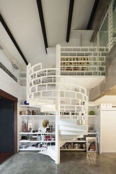 Chic Industrial Loft Design Idea Showcases Original Elements- The Hip Spiral Staircase makes the room.