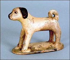 """PENNSYLVANIA REDWARE DOG, 19th c., with a cream and brown glaze, 3 1/4"""" h., 4"""" w."""