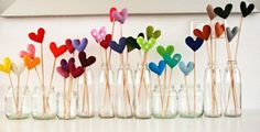 felt hearts on sticks--cute centerpiece idea. Maybe if you did it on pencils you could send them home as favors