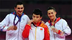 (R-L) Silver medallist Marcel Nguyen of Germany, gold medallist Zhe Feng of China and bronze medallist Hamilton Sabot of France pose on the podium during the Victory ceremony for the Artistic Gymnastics men's Parallel Bars on Day 11 of the London 2012 Olympic Games at North Greenwich Arena