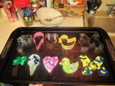 Cookie cutter suncatchers. Heat over to 400 deg and fill cookie cutter with 1 layer of plastic beads. Place in oven for 20 minutes. Remove and allow to cool. Once cooled pop sun catcher out of cookie cutter.