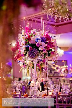stunning purple and white candelabra centerpiece with crystal accents ~ we ❤ this! moncheribridals.com