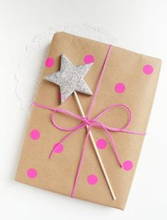 Fun wrapping for a kid's present. Pink dots and a star wand.