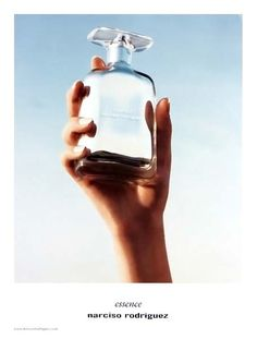 Advert of the fragrance Essence(2009) by Rodriguez Narciso