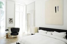 Modern white bedroom with abstract art via @thouswellblog