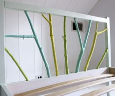 This hack requires a very inexpensive twin Fjellse Ikea bed frame, paint, and free branches from the great outdoors.