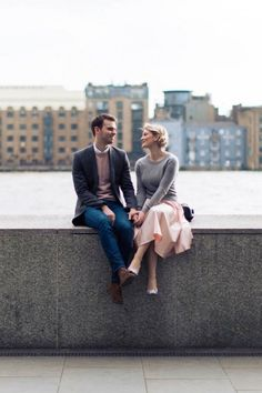 The pops of pastel pink in this couple's outfits looks perfect against the urban backdrop | Miss Gen Photography