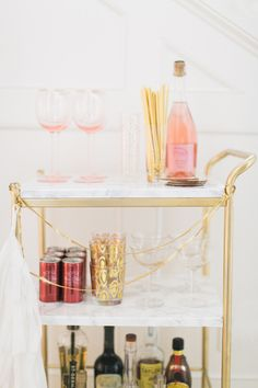 Ikea Hack: DIY Mini Bar Cart - http://www.stylemepretty.com/living/2015/12/29/ikea-hack-diy-mini-bar-cart/