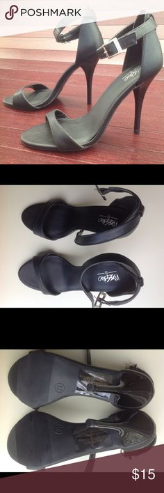 """Barely-there High Heels On trend.  Modern classic.  Black Mossimo brand high heel sandals from Target. Ankle strap with silver buckle.  Size 7.5.  4.25"""" heel height.  Never worn outside. Better fit for a narrow foot. Size/info sticker still on sole. Mossimo Supply Co Shoes Heels"""