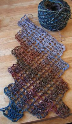 "crochet scarf pattern - this is pretty but uses ""string"". Maybe someday I'll get over my aversion to this.  Still working on one from sock yarn."