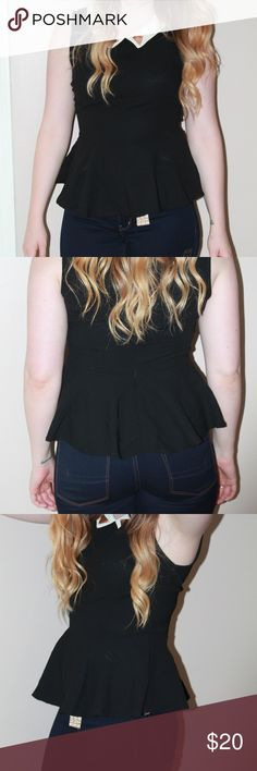 Black Peplum Top with Gold Peter Pan Accents Black peplum top  Peter pan collar with gold, triangle accents  Never worn- No tags  Size Medium (Would also fit a small) Tops