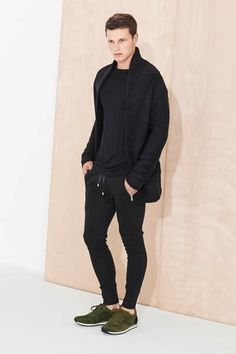 weird sweater. i like the idea of this. joggers, and a long sleeve black swoopy shirt, and tennis shoes.