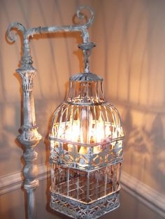 Chandelier floor lamp birdcage light. This standing lamp is a stunning statement piece that goes wherever a romantic flourish is needed.