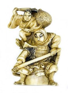 JAPANESE CARVED IVORY NETSUKE Meiji Period (1868-1912). Signed. Of two armored warriors, carrying defense weapons. Height 1 3/4 inches.