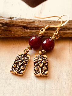 A personal favorite from my Etsy shop https://www.etsy.com/listing/584139294/garnet-lotus-earrings